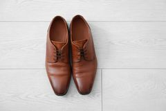Elegant male shoes. On wooden floor Stock Image