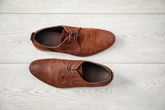 Elegant male shoes. On wooden floor Stock Photography