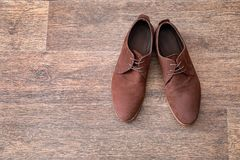 Elegant male shoes. On wooden floor Royalty Free Stock Photography