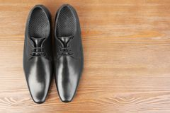 Elegant male shoes. On wooden background Royalty Free Stock Image