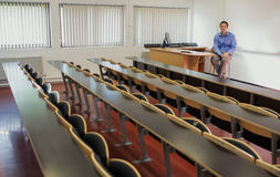 Elegant male teacher sitting in the lecture hall Stock Image