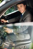 Elegant man. Vertical portrait of an elegant man driving a car Stock Photography