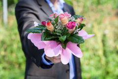 Elegant man with bouquet Royalty Free Stock Photography