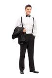 Elegant man carrying his coat and posing Stock Images