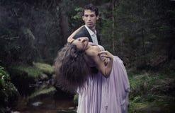 Elegant man carrying woman Stock Photography