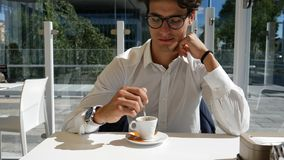 Elegant man drinking coffee outside Stock Image