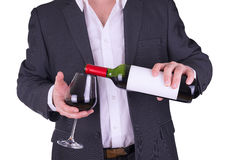 Elegant man drinking red wine. Stock Images