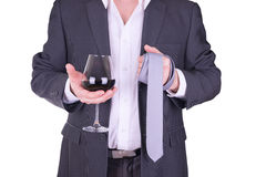 Elegant man drinking red wine. Royalty Free Stock Photos