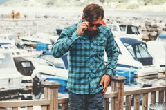 Elegant Man Fashion Lifestyle success concept businessman walking yachts Stock Photography