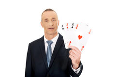 Elegant man with four aces Royalty Free Stock Photography