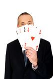 Elegant man with four aces Stock Images