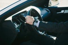 Elegant man in his car Stock Images