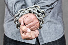 Elegant man with his hands chained Stock Photo