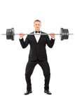 Elegant man holding a heavy weight Royalty Free Stock Image