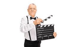 Elegant man holding a movie clapperboard Royalty Free Stock Photos