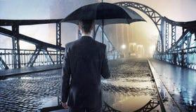 Elegant man holding an umbrella Stock Photo