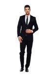 Elegant man i svart dräkt, på vit royaltyfri fotografi