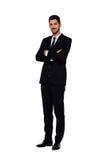 Elegant man i svart dräkt, på vit royaltyfri bild