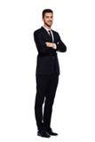 Elegant man i svart dräkt, på vit arkivbilder