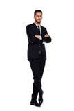 Elegant man i svart dräkt, på vit arkivfoto