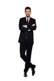 Elegant man i svart dräkt, på vit fotografering för bildbyråer