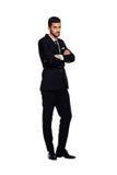 Elegant man i svart dräkt, på vit arkivfoton