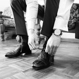 The elegant man laces shoes Royalty Free Stock Photo