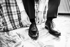 The elegant man laces shoes Royalty Free Stock Photos