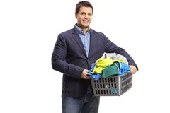 Elegant man with a laundry basket full of clothes Stock Photography
