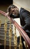 Elegant man leaing on handrail Stock Photo