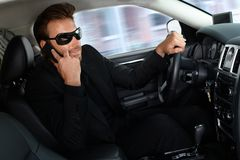Elegant man in limousine on phone Stock Image