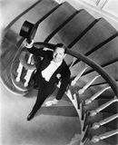 Elegant man looking up from the bottom of a staircase. (All persons depicted are no longer living and no estate exists. Supplier grants that there will be no Royalty Free Stock Image