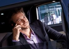 Elegant man in luxury automobile smiling Stock Photo