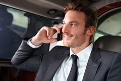 Elegant man in luxury car Royalty Free Stock Image