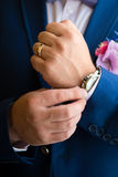 Elegant man. Men's hands with the clock. The gentleman with the watch. The dress code is. Elegant man. Businessman and politician, a rich man. Golden youth Royalty Free Stock Image