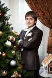 Elegant man near christmas tree Royalty Free Stock Images