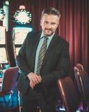 Elegant man near slots machines in a luxury casino interior Stock Photography