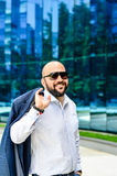 Elegant man outdoor. Handsome bearded smiling    businessman outdoor Stock Photo