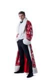 Elegant man posing in coat of Santa Claus Royalty Free Stock Images