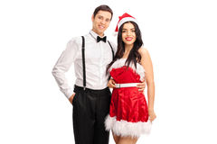 Elegant man posing with a girl in Santa outfit Royalty Free Stock Photos