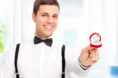 Elegant man proposing with an engagement ring Royalty Free Stock Image