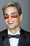 Elegant man with red eye patches. Royalty Free Stock Photos