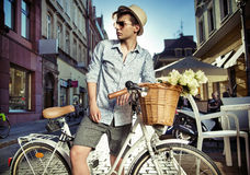Elegant man on the retro bicycle Stock Photo