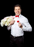 The elegant man with a ring and flowers Royalty Free Stock Photography