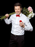 The elegant man with a ring and flowers Royalty Free Stock Photos
