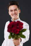 Elegant man with roses Stock Image