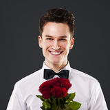 Elegant man with roses Stock Photos