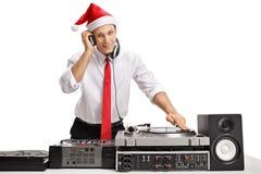 Elegant man with a santa hat playing music royalty free stock photos