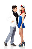 Elegant man seducing a beautiful sailor woman Stock Photography