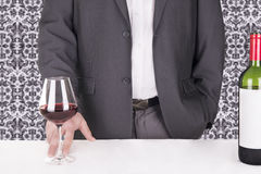 Elegant man serving red wine Royalty Free Stock Photography